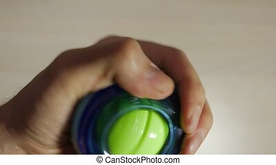 Man rotates the wrist ball, strengthens muscles in hand,...
