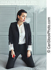 Woman with electric cigarette. - Woman with electric...