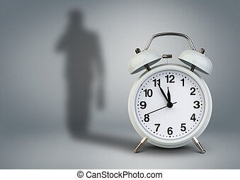 Clock with businessman shadow, time management concept