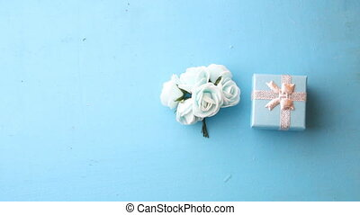 gift box with roses - beautiful roses and gift box on a blue...