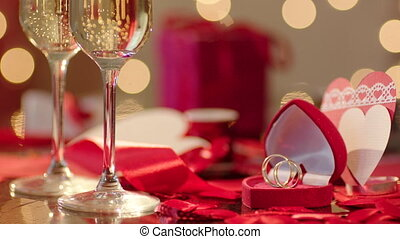 Wedding rings and two glasses filled with champagne