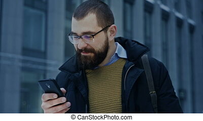 Man using smartphone scrolling