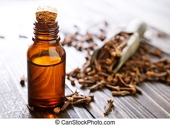 clove oil in glass bottles and on a table