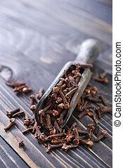 cloves on a table, aroma spice on a table