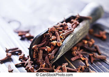 cloves on a table, aroma spice on a table