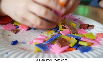 Making colorful wax candle with children - Child mixing wax...
