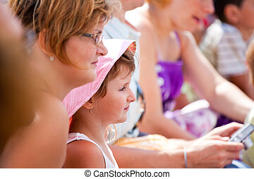 Mother and daughter at the dolphinarium - Mother and...