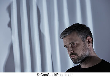 Man with depression - Broken man with depression in room...