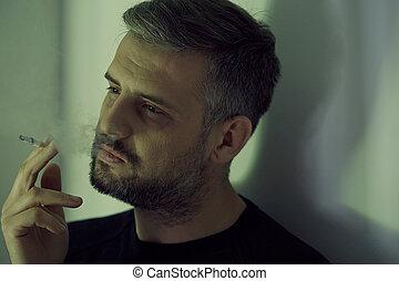 Man smoking cigarette - Addicted and depressed man smoking...