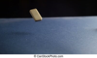 Dominoes falling on the table. Slow motion