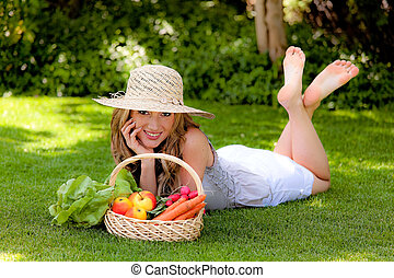 Fruit and vegetables in the basket with his wife - Young...