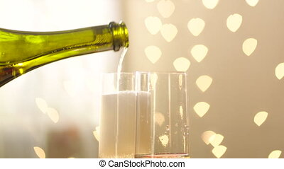 Filling glasses with champagne on wedding day - Panorama of...