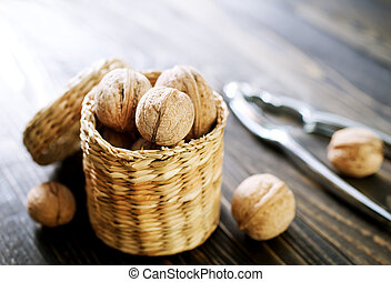 walnuts on the wooden table, dry walnuts