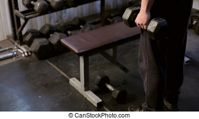 Man Exercising The Biceps In The Gym. Athletic sport...