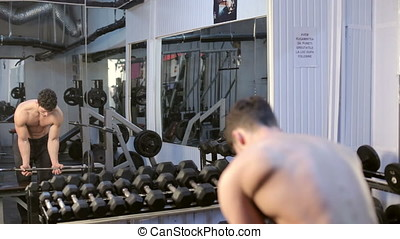 Man Lifting Heavy Weights In The Gym. Athletic sport...