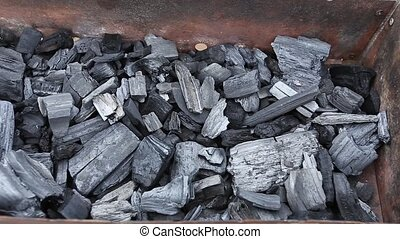 coals in a barbecue grill