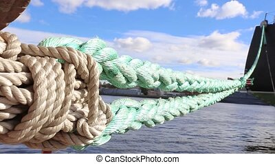 Ship mooring ropes. The ship is at berth