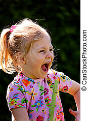 Child laughs out loud and hearty - Small child laughs out...