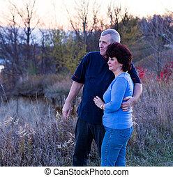 Couple watching sunset.