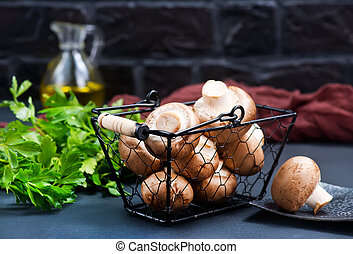 raw mushroom in metal basket and on a table