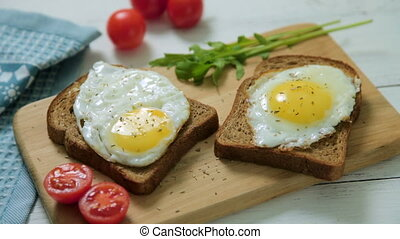 Healthy Breakfast: scrambled eggs on slices of whole-grain...