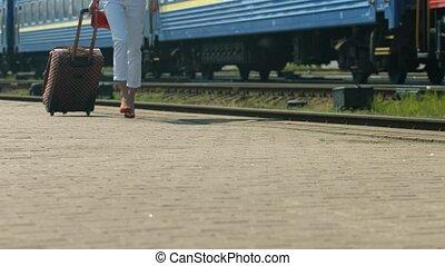 Girl traveling. - Girl goes on the platform. Girl traveling.