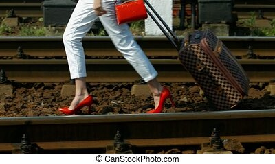Girl with a suitcase. - Girl with a suitcase walking on the...