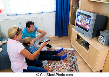 Family watching TV with TV