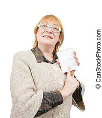 senior woman pointing on empty notebook - smiling senior...