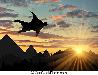 Wingsuit extreme sports. A man in a suit for wingsuit...