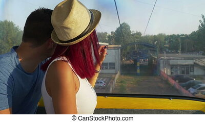 Couple on cable car going down on the ground