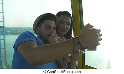 Couple on video call in cable car at the seaside