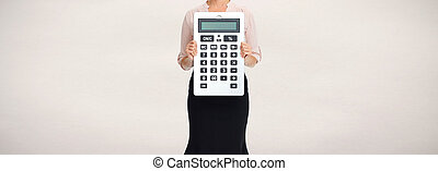 Hands with calculator