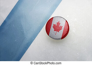 old hockey puck with the national flag of canada. - vintage...