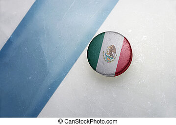 old hockey puck with the national flag of mexico. - vintage...