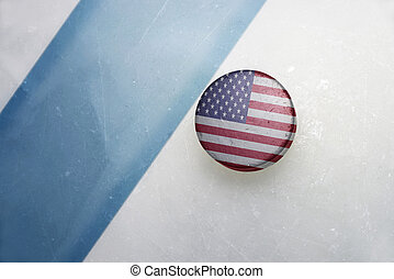 old hockey puck with the national flag of united states of...
