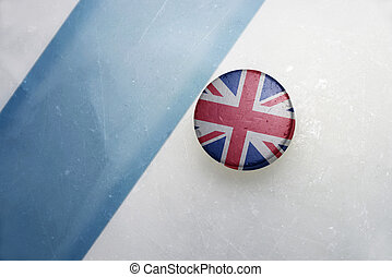 old hockey puck with the national flag of great britain. -...