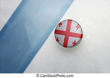 old hockey puck with the national flag of georgia. - vintage...