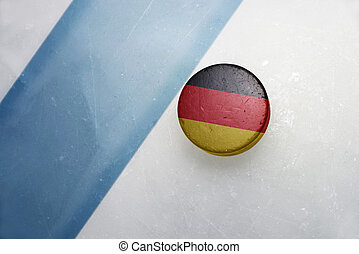 old hockey puck with the national flag of germany. - vintage...