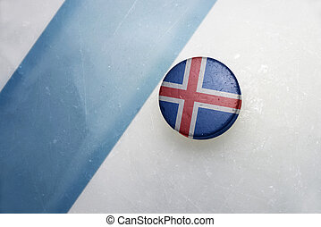 old hockey puck with the national flag of iceland. - vintage...