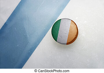 old hockey puck with the national flag of ireland. - vintage...