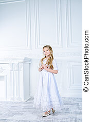 innocence - Beautiful little girl in white dress. Kid's...