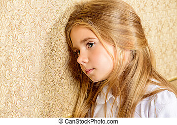 childrens melancholy - Portrait of a sad little girl.