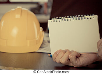 Construction industy with blank notebook for cope space