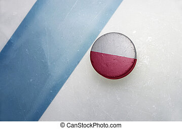 old hockey puck with the national flag of poland . - vintage...