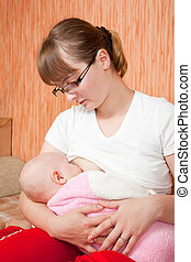mother breast feeding baby