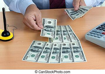 U.S. dollars banknotes are counted - Many dollars banknotes...
