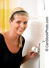 Save energy. Thermostat of the heater. Heating costs.