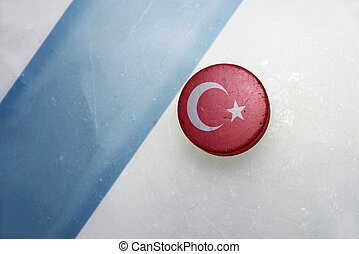 old hockey puck with the national flag of turkey. - vintage...