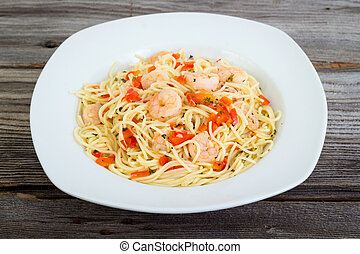 shrimp garlic pasta plate on wood table background